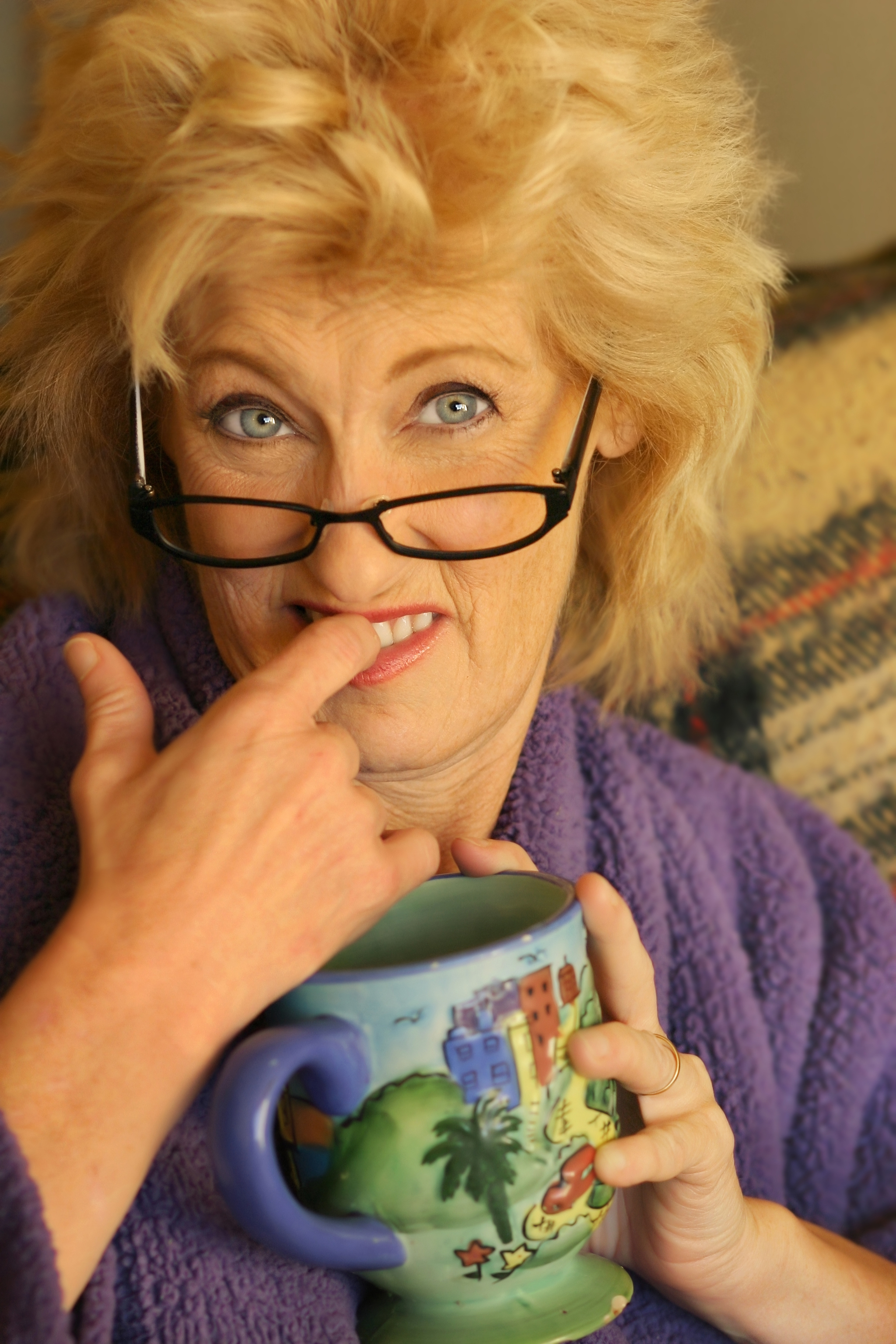 Woman biting figner